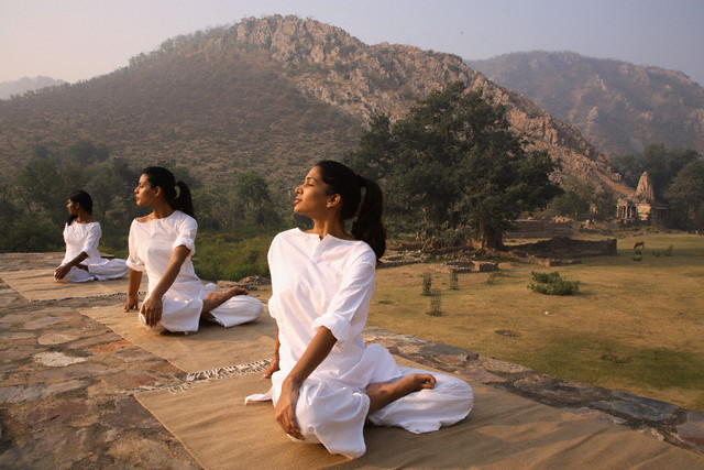 Women Practicing Yoga at Bhangarh