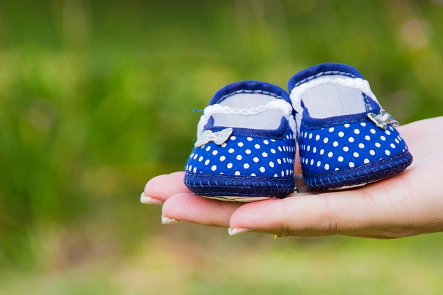 Surrogacy is like a Gift to intended parents: Baby Shoes: Surrogate emotions Pic: Baby shoes in hand for Surrogacy Cost in India